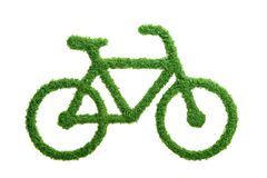 Green grass eco bicycle isolated. Grass growing in the shape of a bicycle. Choose a healthy lifestyle and protect the environment Stock Photo