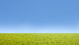 Green Grass Field And Bright Blue Sky. Stock Image