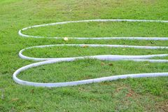 A curved of white rubber tubes royalty free stock photos