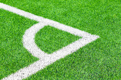 Green grass field and corner lines in an football stadium Royalty Free Stock Photography