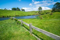 Green Grass Field in the Countryside Landscape. Peaceful British rural area scenery. Beautiful agriculture farmland and pasture grassland in the country Stock Photo