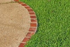 Green grass field. Edge of trimmed green grass field Stock Photo