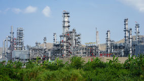 Green grass field and Oil refinery factory plant or petrochamical and power.  royalty free stock images