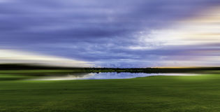 Green Grass Field With Pond Royalty Free Stock Photography