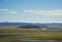 Green grass field and river ,tibet,china Royalty Free Stock Photos