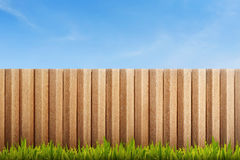 Green grass field with wooden fence Stock Photo