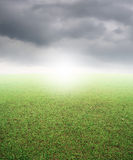 Green grass fields and beautiful rainclouds Stock Images