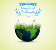 Green grass and flowers inside earth for International biodiversity day background. Illustration of Green grass and flowers inside earth for International Royalty Free Stock Photo