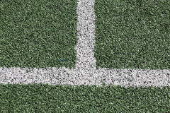 The Green grass football field conner Stock Image