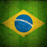 Green grass of a Football playground. With Brazil flag. Grunge background Royalty Free Stock Image