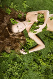 On green grass is a girl with beautiful hair Stock Photography