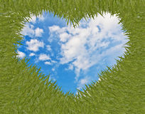 Green grass with heart shape frame Stock Images