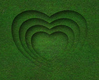 Green grass heart shape on green grass background Royalty Free Stock Photos