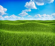 Green grass hills and blue sky landscape Royalty Free Stock Images