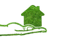 Green grass home icon in his hand. Abstract green grass house on over white background. Ecology concept royalty free stock photo