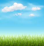 Green Grass Lawn with Clouds on Blue Sky Royalty Free Stock Image