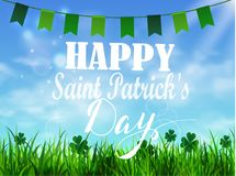 Green grass lawn with sunrise on blue sky. Floral nature spring with Saint Patrick s day greetings background Stock Images