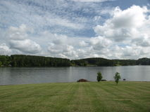 Green grass leading to the lake. A view of lake Hickory in North Carolina Royalty Free Stock Images