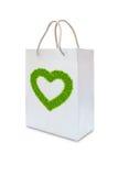 Green grass love heart on white paper bag Stock Photo
