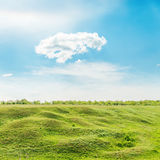 Green grass meadow and cloud in blue sky Royalty Free Stock Images
