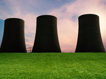Green grass with nuclear power plant. Green grass with silhouette nuclear power plant Royalty Free Stock Photos
