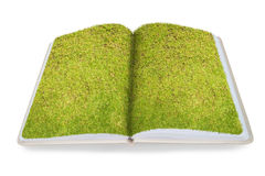 Green grass on open recycled note book isolated on the white bac Stock Image
