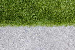 Green grass and the other half is granite. Royalty Free Stock Photography