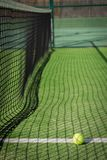 Paddle tennis court and net with a ball on the net shadow Royalty Free Stock Photos