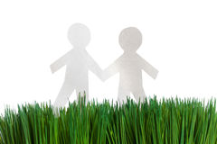 Green grass and Paper Chain men Royalty Free Stock Photos