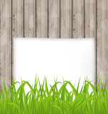 Green grass and paper sheet on wooden texture Royalty Free Stock Photos