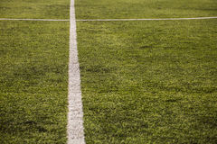 Green grass pattern for football sport, Football field, soccer field, team sport texture. White stripe on it. Close up. Focus Royalty Free Stock Image