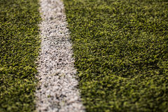 Green grass pattern for football sport, Football field, soccer field, team sport texture. White stripe on it. Close up. Focus Royalty Free Stock Images