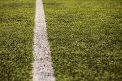 Green grass pattern for football sport, Football field, soccer field, team sport texture. White stripe on it. Close up. Focus Royalty Free Stock Photography
