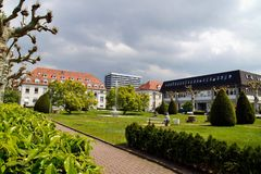 Green grass in public park and building. stock photo
