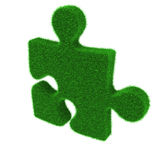 Green grass puzzle piece Stock Photos