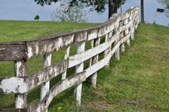 Ragged Wood Fence on a Ranch in Texas. Green Grass and a Ragged Fence, along the road side, anywhere Texas royalty free stock photos
