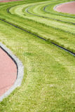 Green grass with sinuous rails Royalty Free Stock Photos