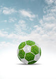 Green grass of soccer ball design on clouds blue sky Stock Image