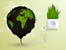 Green grass and socket plug. The concept of clean energy Royalty Free Stock Photography