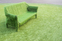 Green grass sofa. Empty green artificial grass sofa on artificial grass Royalty Free Stock Photos