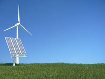 Green grass with solar panel and wind generator. Abstract scene Stock Photo