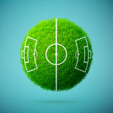 Green grass sphere with soccer field on a blue clear background Stock Photos