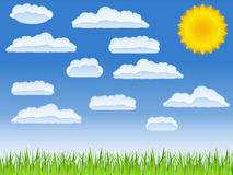Green grass, sun and clouds Royalty Free Stock Photography