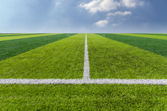 Green Grass Texture in Soccer Field with Sky. Stock Image