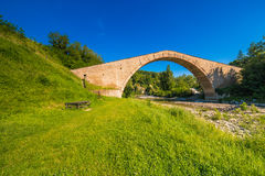 Green grass to ancient bridge royalty free stock photography
