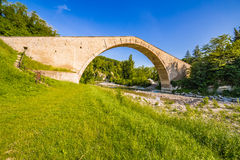 Green grass to ancient bridge royalty free stock photo