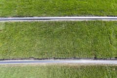 Green grass tram tracks Royalty Free Stock Image
