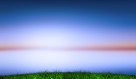 Green grass under blue and purple sky Royalty Free Stock Photo