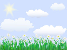 Green grass under blue sky. With sun an clouds Royalty Free Stock Photos