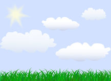 Green grass under blue sky. With sun an clouds Stock Photo